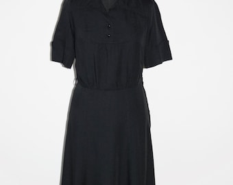 Black mid-length seventies dress, short sleeved, made in Finland. Eu size 38