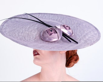 Jan. Large sinamay saucer hat with cabachon roses and spadonas
