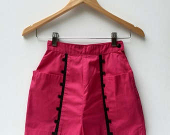 Adorable 1950s 'Koret of California' high waisted fuchsia cotton shorties with pockets and black vertical trim