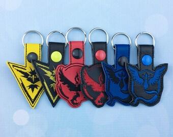 Pokémon GO Keychain Pokemon Go Team Valor Team Instinct Team Mystic Pokemon Go Key Fobs Keychains Zipper Pulls Bag Tags