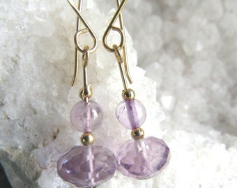 Earring with an 8mm faceted lavender amethyst bead, 12k goldfilled wire, and handmade french earwires, length 1 1/4 inches.