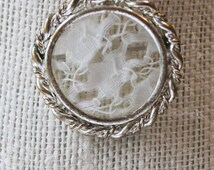 Antique Picture brooch pin or mourning pin, has a piece of antique hand-tatted lace inside