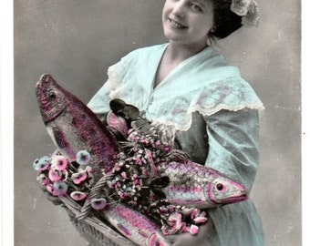 APRIL FOOLS DAY Postcard -- Happy Fishwife Displays her Fish Bouquet! (real photo)