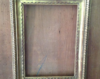 19 th century carved wood  with stucco frame