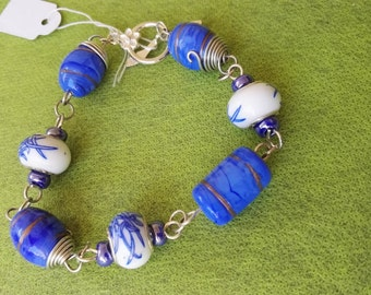 Hand made wire wrapped bracelet  blue and white beads