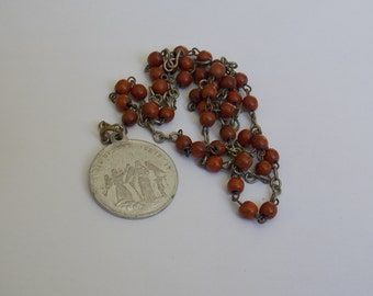 small rosary and his medal wooden beads