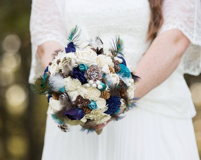 Peacock wedding bouquet in shades of blue, brown and ivory