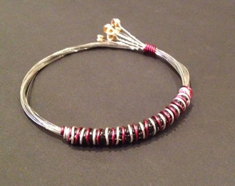 A Handmade Recycled Guitar String Bracelet/bangle Burgundy and silver wire