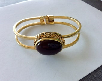 Vintage Clamper Bracelet Gold Tone with Oval Chocolate Brown Faux Stone Cabochon