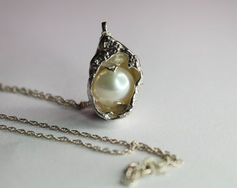 Pearl cradled in an Abstract Sea shell pendant necklace Made from Sterling Silver