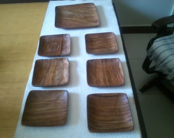 Hand  crafted  rose  wood,  set  of  seven  plates  six  small  &  one  big.