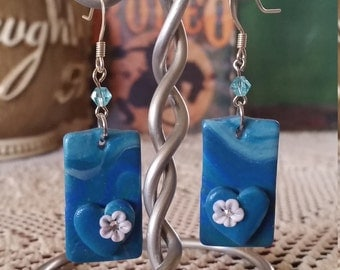 Polymer blue and turquoise heart earrings, with white flower and crystal center