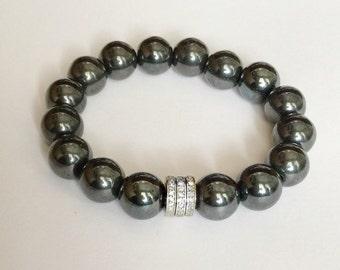 Hematite gemstone and 0.66 carat pave diamond bracelet