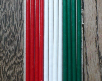 Guild House Floral Tapers, 12 narrow candles 15 inches tall, 4 each red, white, and green, in original box