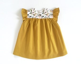 girls gold cotton dress with floral detail