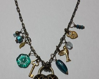 Reversible Antiqued Brass Heart Necklace With  10 Dangles