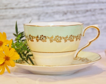 Vintage COLLINGWOODS Pale Yellow and Green and Gilt Teacup and Saucer, England
