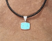 Sterling Silver Inlaid Sleeping Beauty Turquoise Pendant on Square Braided Horsehair Necklace with Sterling Clasp