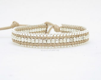 Single wrap bracelet with silver plated chain on soft beige polyester cord