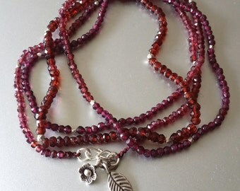 Faceted LONG Garnet NECKLACE with Sterling Leaf and Flower Charm