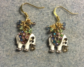 White enamel and colored rhinestone elephant charm earrings adorned with tiny dangling blue, purple, and green Chinese crystal beads.