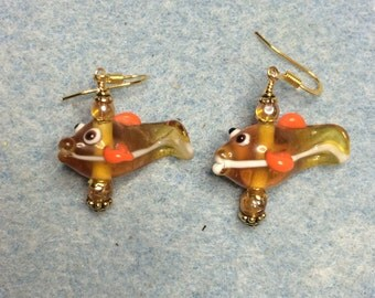Amber and orange lampwork fish bead earrings adorned with amber Czech glass beads.