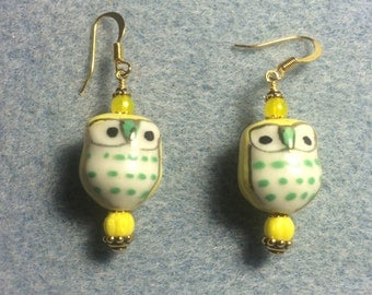 Yellow with green spots ceramic owl bead earrings adorned with yellow Czech glass beads.