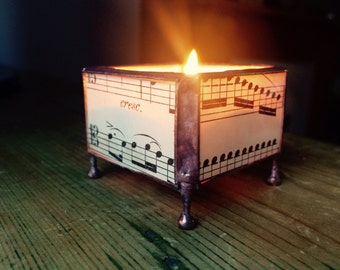 Musical score candle holder