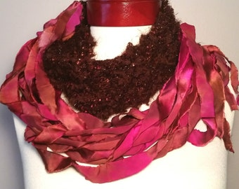 Brown, fuschia, persimmon, peach, apricot. Unique hand knit Infinity scarf. Hand dyed silk. Versatile and stylish, you'll never take it off!