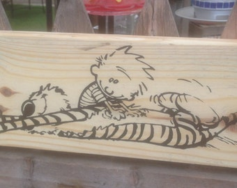 Calvin and Hobbes on reclaimed wood