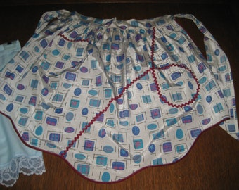 2 beautiful vintage Aprons with bric a brac and lacy trim pockets **free shipping