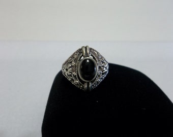 Sterling silver black onyx ring size 7. Comes in ring box.