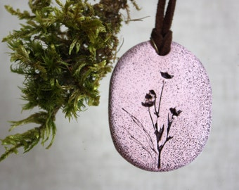 Pendant made of polymer clay. Pendant with a print of plants. Pink pendant