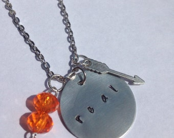 The Hunger Games Inspired Charm  with Handstamped 'REAL' charm