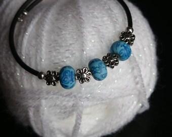 Blue flowery memory wire bracelet # 138