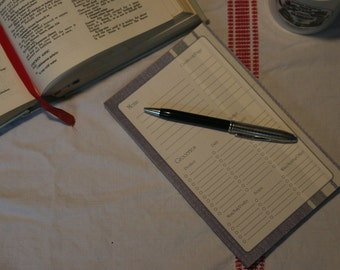 Blue menu and detachable grocery list fashioned from blue French ticking fabric.