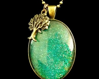 Sparkling glittering Blue and green pendant on bronze chain necklace