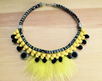 Ethnic necklace with Strawberry and yellow feathers!
