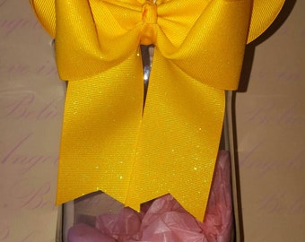 Double tails down hair bow with glitter ribbon.