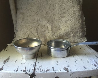 Vintage aluminum measuring cup and canning funnel