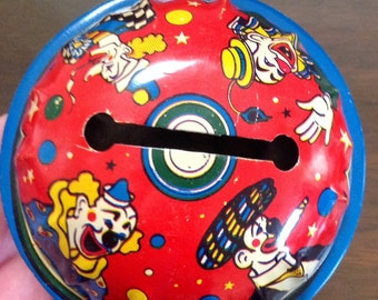 Tin Lithographed Noise Maker with Clowns 1940s