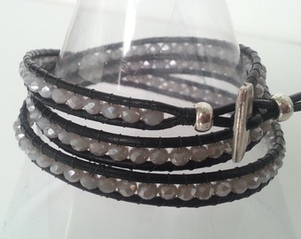Wrap bracelet with gray color beads.  Three rounds