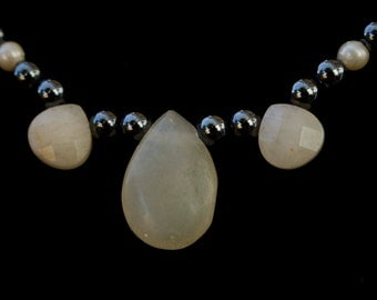 White Stone Tear Drop Necklace with black hematite like beads