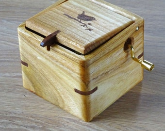 Music box of cherry wood. Melody choice. e.g. Brahms Lullaby