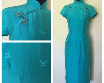 Original Vintage 1950's Chinese Cheongsam Aqua/ Light Turquoise Color Dress with Mandarin Collar and Frog Buttons. Size: S - M.