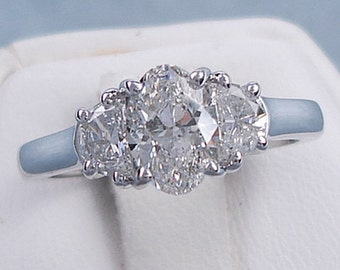 Beautiful 1.53 ctw Oval Cut Diamond Engagement Ring with a 1.00 Oval Cut H Color/SI1-SI2 Clarity Enhanced Center Diamond
