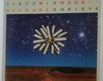Stomu Yamashta, Michael Shrieve, Steve Winwood - GO, 1976 stereo vinyl  long-playing record album, ILPS-9387