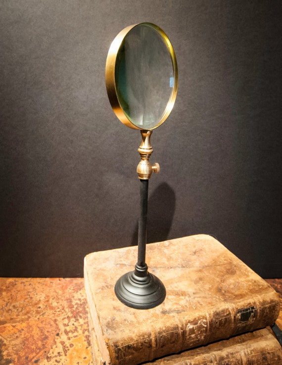 Vintage Magnifying Glass On Black Metal Stand By