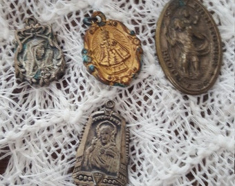 Lot of four antique religious metals.....aged patina....charming and spiritual.