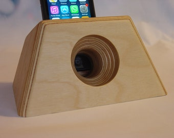 iPhone docking and charging station with built in acoustic amplifier. Made for all iPhone models.